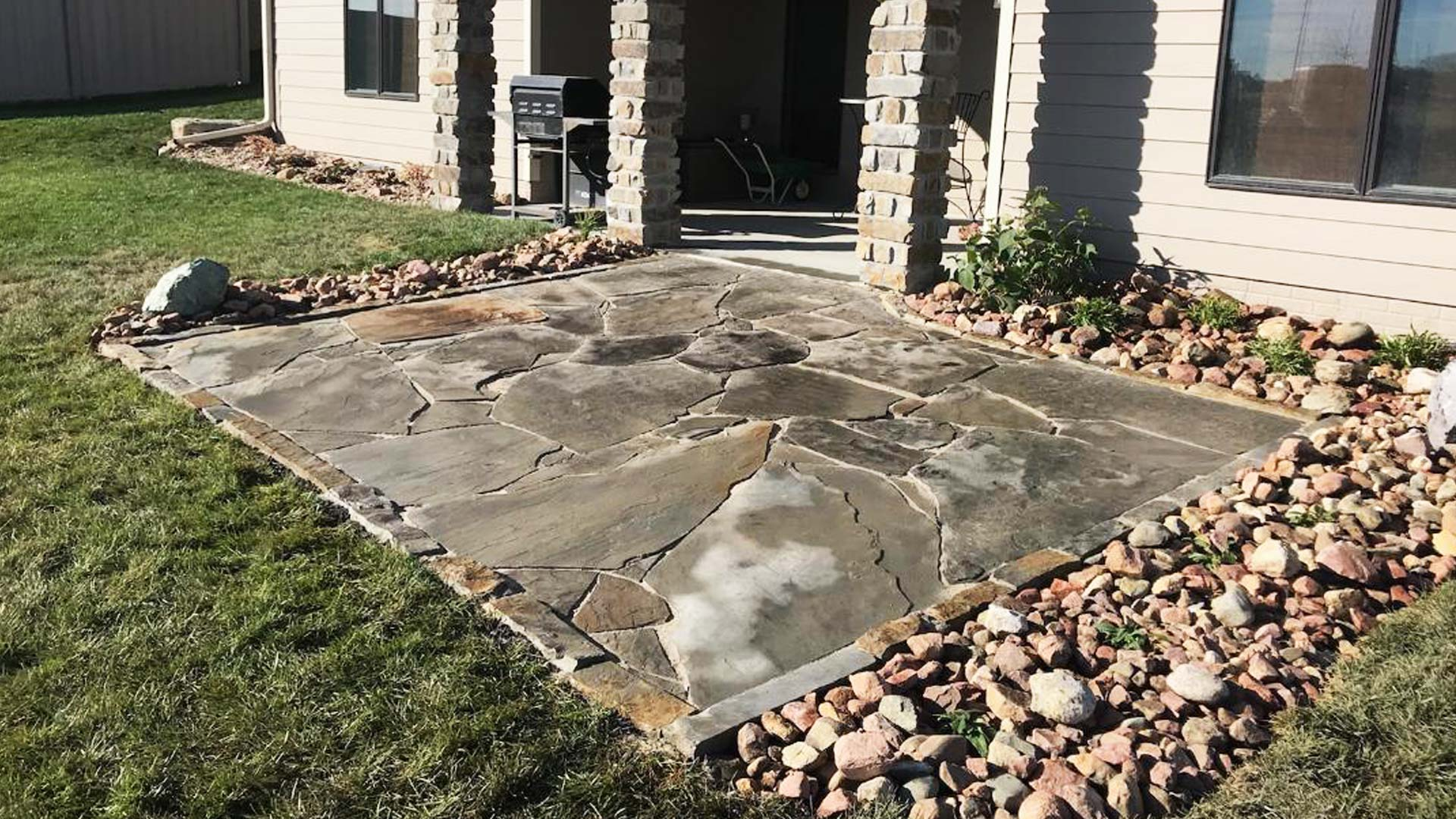 Newly installed flagstone pation in the backyard of a home in Lancaster County.