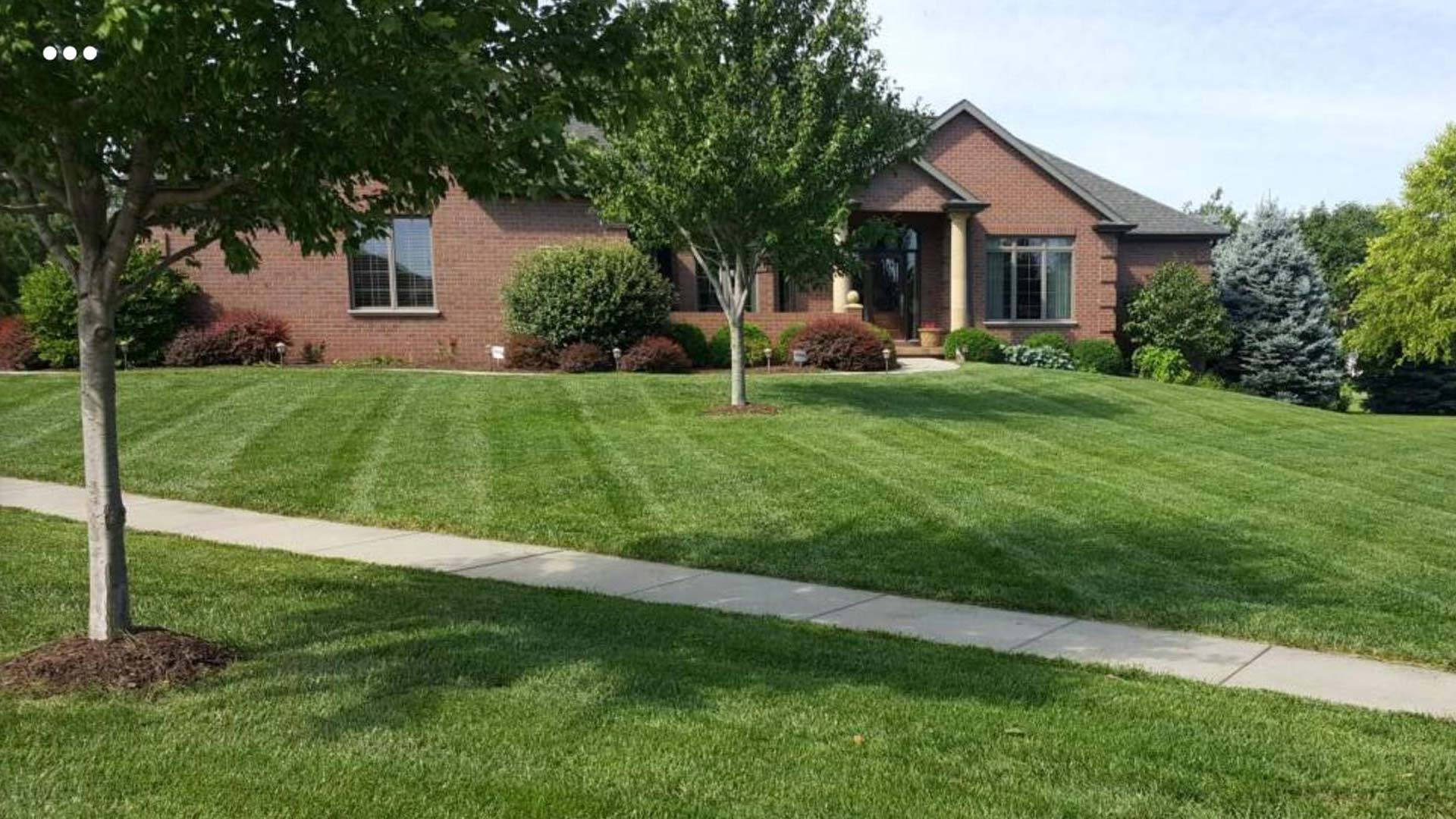 A large residential property in Lincoln, NE that our team maintains the lawn and landscape on a regular basis.