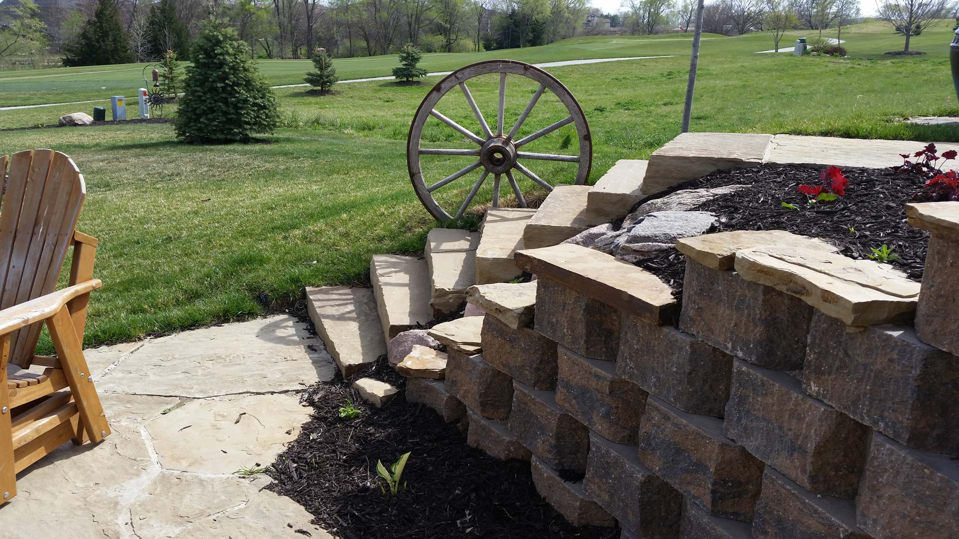 Retaining wall designed and installed with new landscaping at a home in Lancaster.