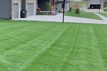 Lincoln home with a professional lawn care service.